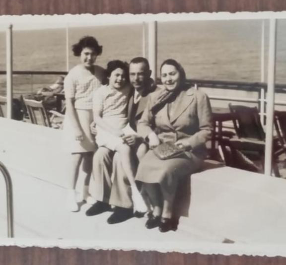 Omy with her sister and parents on a boat to Palestine